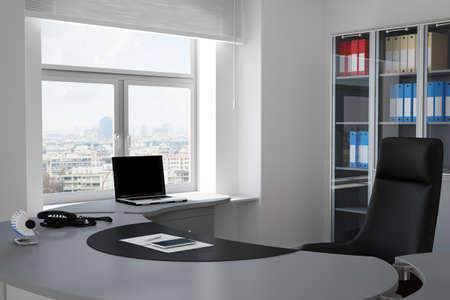 Office with urban view through window and grey table photo