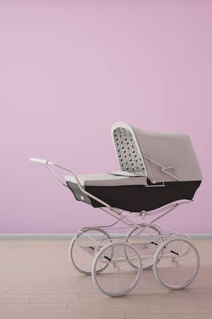 Baby stroller on pink wall with wooden floor photo