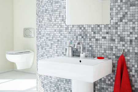 Bathroom closeup with tiles and ceramic sink Stock Photo - 24936086