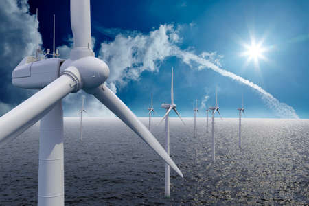 Wind power offshore with clouds and sun photo