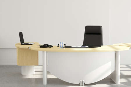 Office desk close up with chair and laptop
