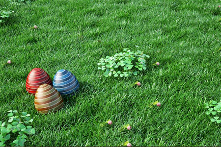 Easter background with eggs in green grass