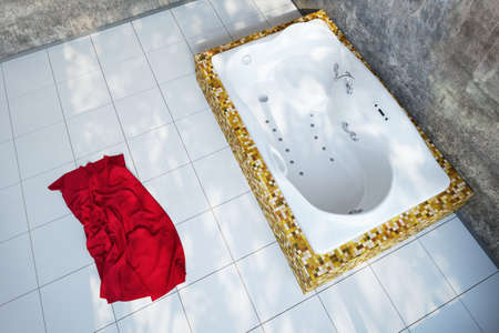 Urban Bathroom with red towel and grungy look