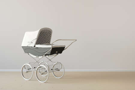 Vintage baby buggy with copy space on wooden floor photo