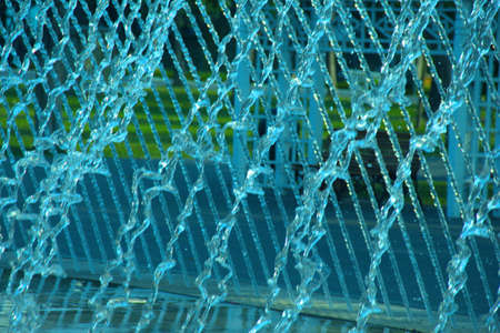 gratings: gratings formed by the fall of water from a sink Stock Photo