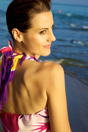medium shot: beautiful female model smiling on the beach medium shot