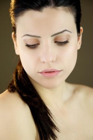 Pure beeld van vrouwelijk model sluiten de ogen Stockfoto