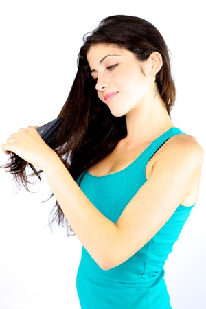 Smiling gorgeous girl brushing her very long hair Stock Photo - 15251760