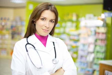 Attractive female doctor working in pharmacy happy Stockfoto