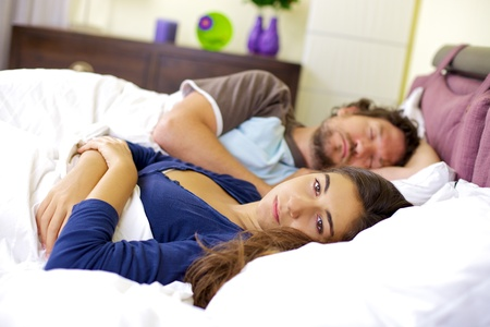 separate: Bad relationship young woman depressed about sleeping boyfriend Stock Photo