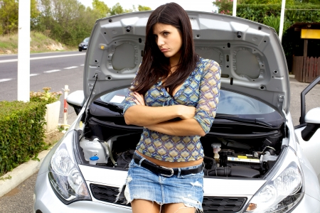 road assistance: Gorgeous female model angry about broken car