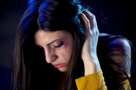 Sad scared woman with wound because of domestic violence photo