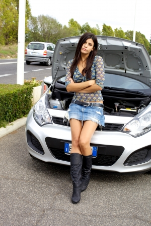 Woman with broken engine waiting depressed