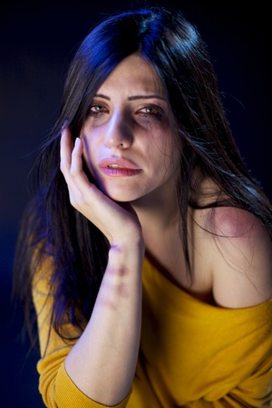 Sad lonely desperate hit woman Stock Photo - 16522851