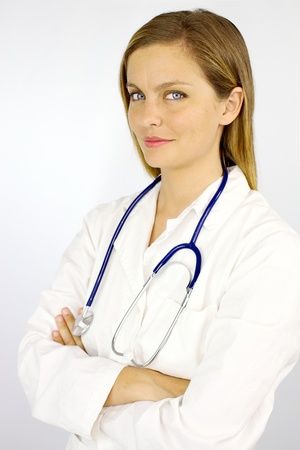 serious doctor: Happy female doctor with blue eyes and blond hair