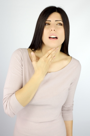 Good looking young woman with very bad throat problem sick Stockfoto