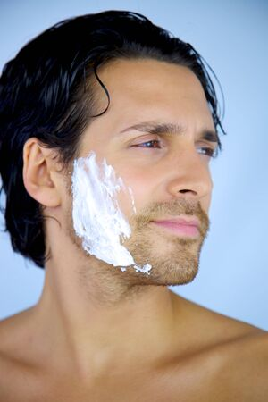 Good looking man with shaving cream on his face smiling happy relaxed Stock Photo - 16734435