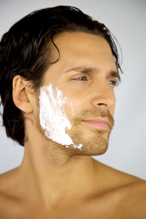 Handsome male model with shaving cream photo
