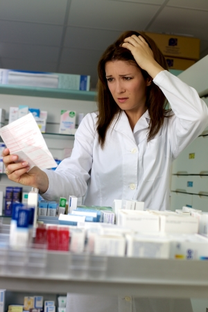 Depressed pharmacist in pharmacy working