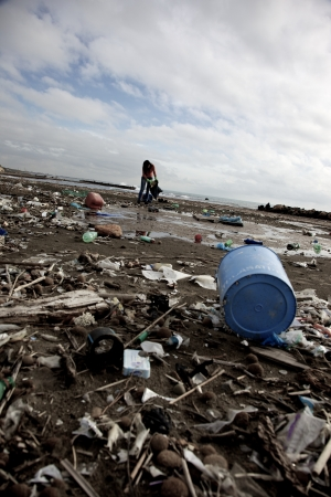 trashy: Beautiful summer day on a destroyed beach ecological disaster Stock Photo
