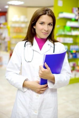 Smiling female pharmacist photo