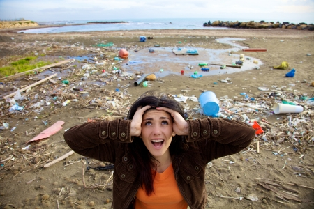 Desperate woman shouting to ask for help because of climate disaster photo