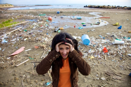 trashy: Sad and depressed woman about destroyed environment Stock Photo