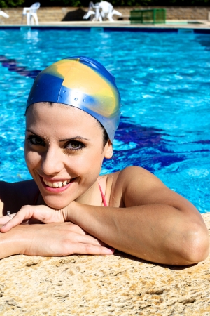 Good looking woman in swimming pool portrait photo