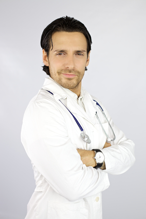 Handsome doctor with white background in studio photo