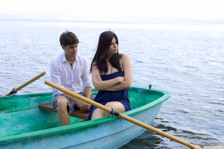 Couple fighting on boat during vacation Stockfoto