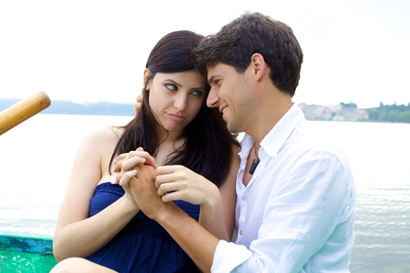 Woman forgiving smiling husband