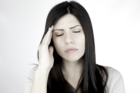 closing eyes: Woman unable to stop strong migraine feeling sic with headache closing eyes hoping to rest