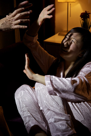 fearing: Domestic violence Chinese american woman at home fearing husband