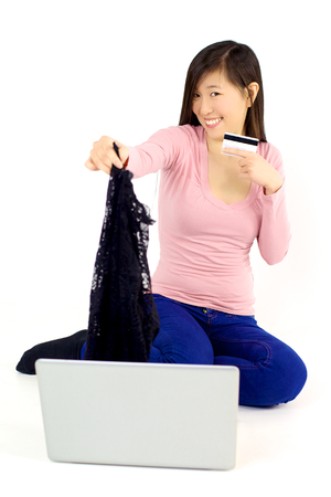 Asian woman with credit card after shopping online photo