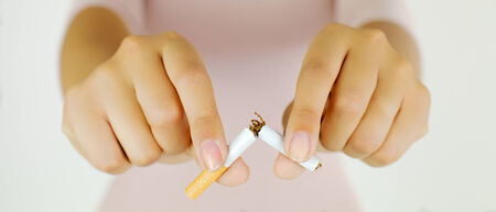 Portrait of hands breaking cigarette photo