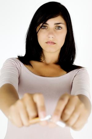 qui: strong woman breaking cigarette to qui smoking Stock Photo