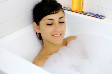 woman in bath: Happy woman inside bath tub having a good time Stock Photo