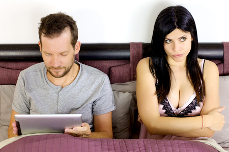 young couple sex: Unhappy wife with husband addicted to technology