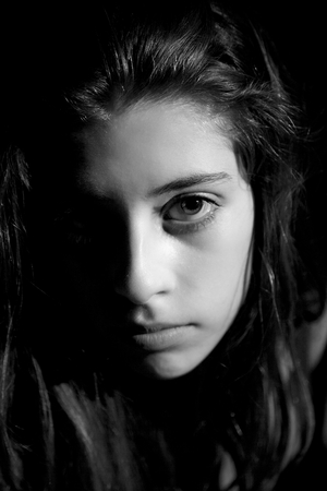 black and white closeup portrait of a sad teenager photo