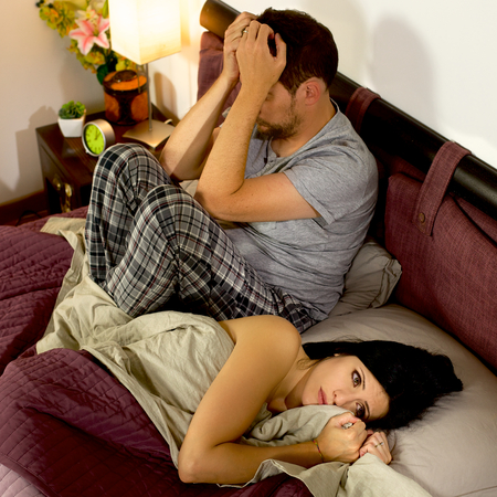 Angry wife and husband not talking in bed