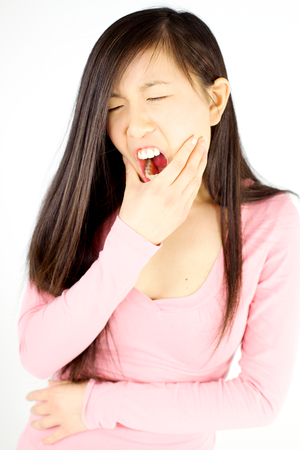 mouth cavity: Young Chinese woman feeling strong teeth pain