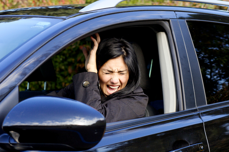 Scared woman not able to prevent car accident photo