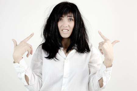 Triest mooie vrouw met een slechte haar dag Stockfoto