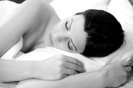 woman sleep: black and white closeup of beautiful woman having good sleep