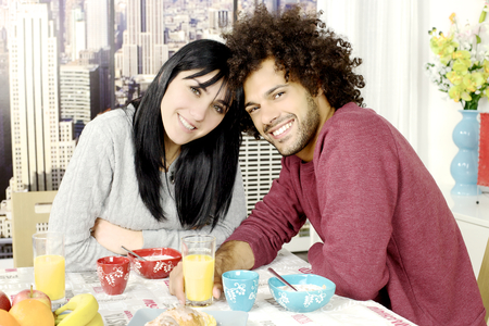 Happy couple in love with cereals fruit and coffee photo