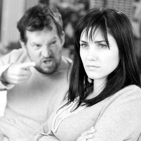 Serious woman not taking care of angry husband photo