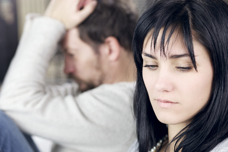 upset man: Unhappy couple after fight not talking to each other
