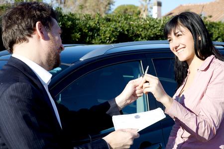 Happy woman buying new black SUV car Stockfoto