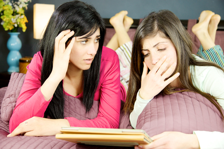 bad news: Unhappy girls scared about bad news Stock Photo