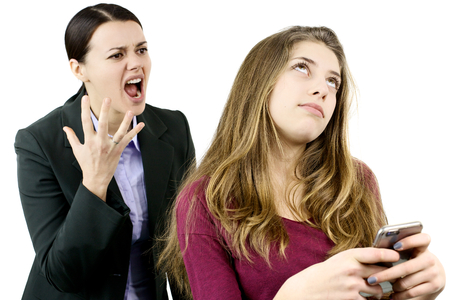 Funny angry woman shouting against teenage daughter